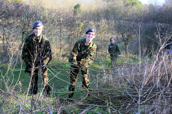 Cadets Toby Jarvis and Chris Lehrer (left to right) stacking Willow staves