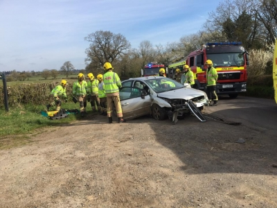 Two car crash closes village road