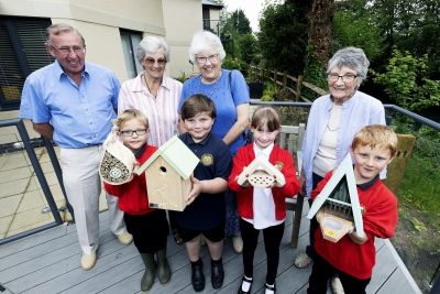 Children help make retirement garden a wildlife haven