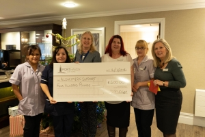 Savernake View Care Home presented a cheque for £400 to Alzheimer's Support