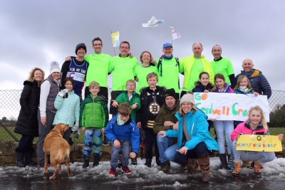 Runners battle against the snow to complete half-marathon