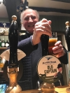 Retiring master of Beaufort Hunt pulls a pint of Old Captain beer
